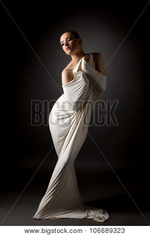 Girl posing in tight cloth like straitjacket