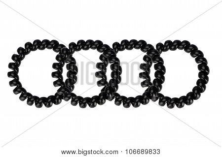 Four black plastic spring scrunchy