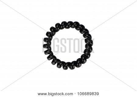 One black plastic spring scrunchy