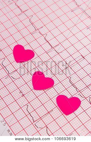 Hearts Of Paper On Electrocardiogram Graph, Medicine And Healthcare Concept