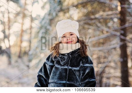 happy child on cozy winter forest walk