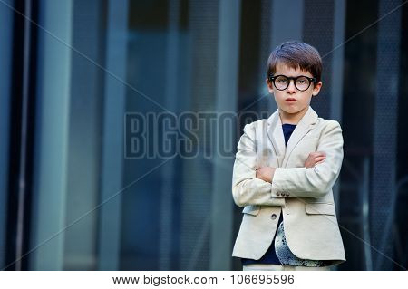 Little boy in a nice suit and glasses. Back to school