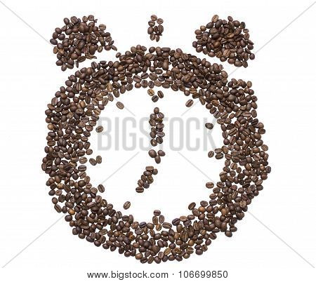 The Dial Of The Clock With Bells Inlaid With Roasted Coffee Beans Showing Seven In The Morning