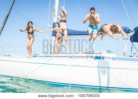 Group Of Friends Jumping From The Boat
