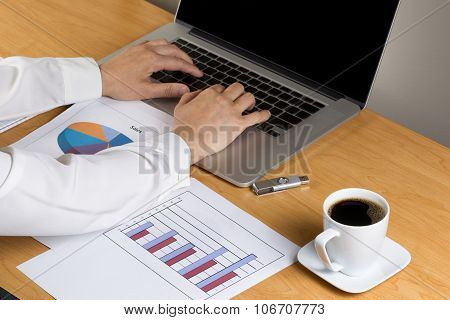 Woman Hands Typing On Laptop Keyboard While Working On Financial Data