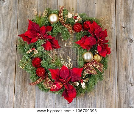 Traditional Holiday Christmas Wreath On Rustic Wooden Cedar Boards
