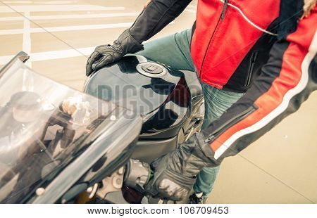 Biker Goes On His Motorbike