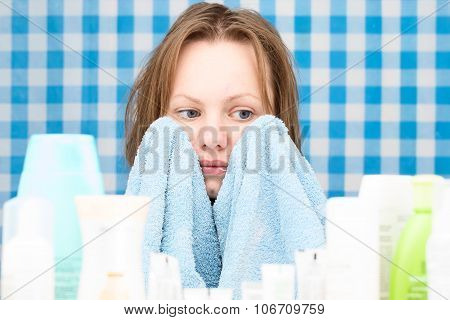Girl Is Covering Her Face With Towel In The Bathroom