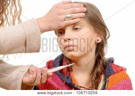 Mother measuring fever of her sick child.