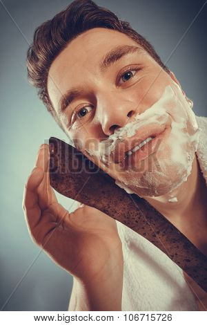 Young Man Shaving Having Fun With Machete.