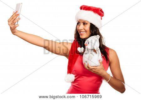 Girl Holds Snowman Taking Selfie