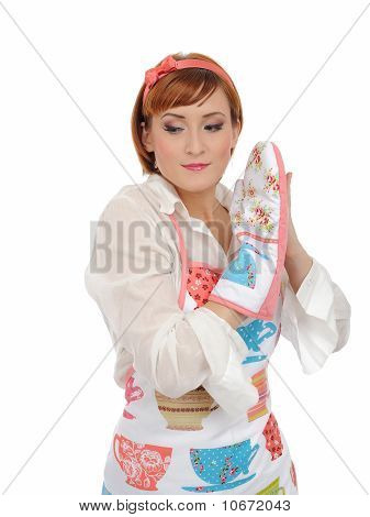 Beautiful Cooking Woman In Apron And Kitchen Glove. Isolated On White Background