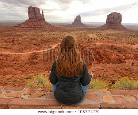 Peaceful Moment In Monument Valley While Meditating