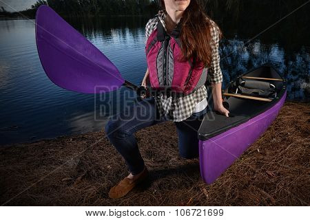 Woman And Kayak At Lake In The Fall