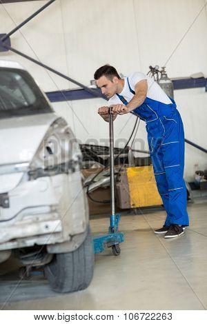 auto mechanic manual lift car in service