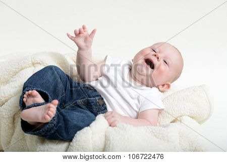 Small Infant With A Funny Expresion While Laughing