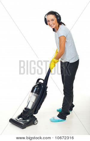Happy Woman With Headphones And Vacuum