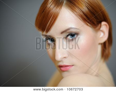 Portrait Of Pretty Woman With Pure Healthy Skin And Retro Make-up In Brown Tones