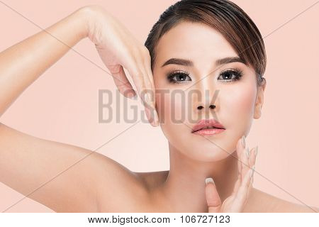 Beautiful spa woman with clean beauty skin touching face