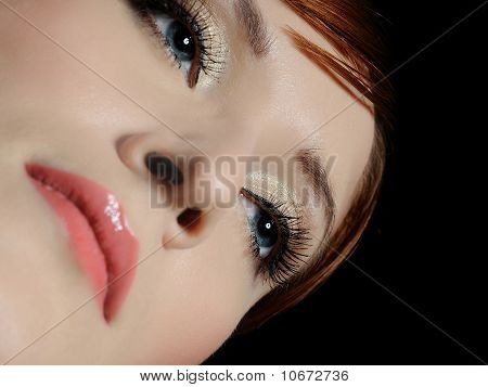 Beautiful Macro Shot Of Blue Woman Eyes With Long Lashes And Make-up In Brown Tones