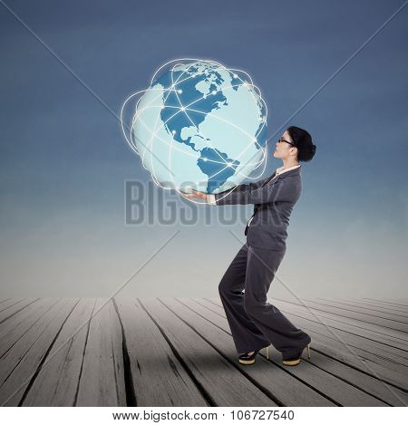 Businesswoman Holding Blue Earth Planet