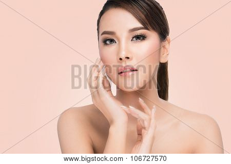 Beautiful Asian Girl Touching her Face,woman with beauty face and perfect skin.