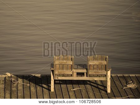 Empty Bench Overlooking The Water In A Tranquil And Relaxing Scene
