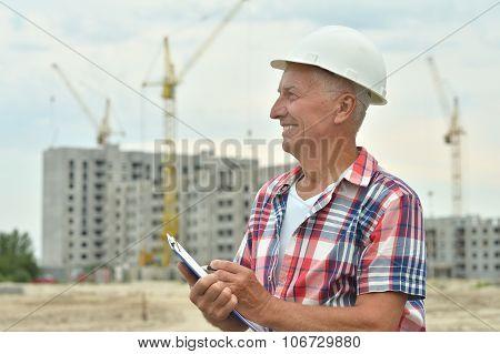 Senior man in under construction