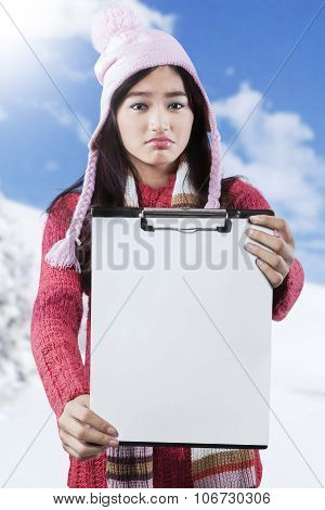 Frustrated Girl Showing Empty Clipboard