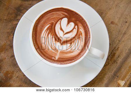 Mug of hot chocolate or cocoa a wood table coffee with heart shape