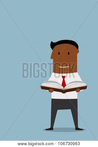 Intelligent businessman reading a book