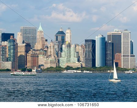 View of Lower Manhattan from the New York Harbor with boats sailing on the ocean