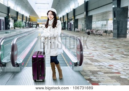 Girl Standing With A Suitcase In The Airport Hall