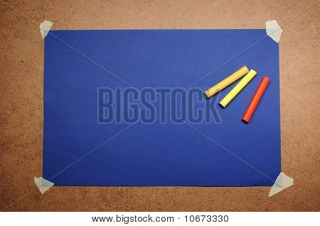 Empty Blue Cardboard Background And Multicolored Pastel - Art Utensil