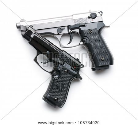 two handguns on white background