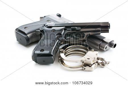 handguns and handcuffs on white background