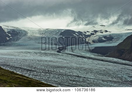 Landscape of Vatnajokull glacier with dramatic clouds above