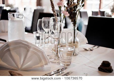 Wedding table setting with elegant white decoration
