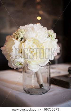 Wedding bouquet with white peonies on table