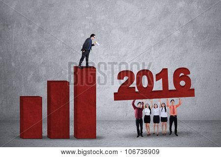 Man Standing On Chart And Yelling At His Partners