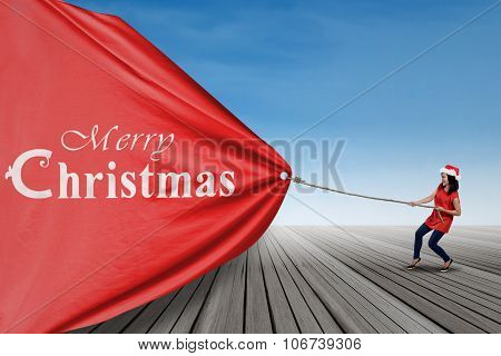 Student Woman Pulling Big Christmas Banner