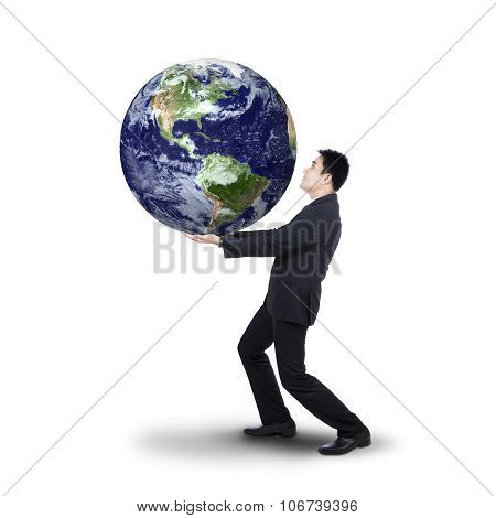 Successful Businessman Holding Earth Planet
