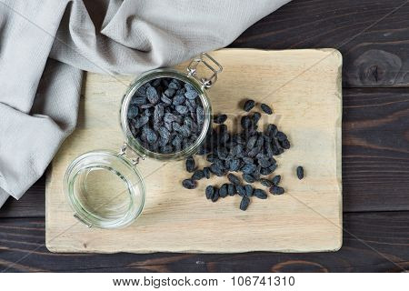 Natural organic dried grapes raisins, rustic still life