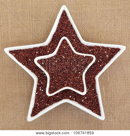 Quinoa grain super food in star shaped dishes over hessian background. Salvia hispanica.