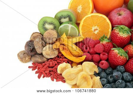 Mixed superfood fruit selection over white background with copy space.