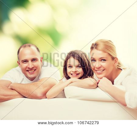 family, childhood, ecology and people - smiling mother, father and little girl over green background