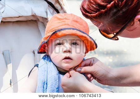 Baby With Orange Cap