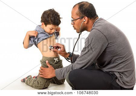 Doctor Is Checking A Boy With A Stethoscope