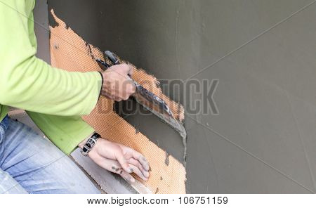 Plastered Walls With A Large Spatula