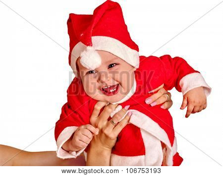 Baby boy clothing for Santa hats on mother hands. Isolated.